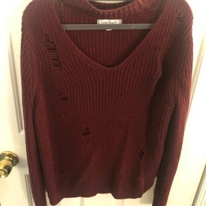 Red ripped design sweater